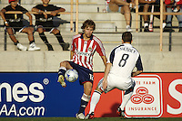 Chivas USA defender Carey Talley (12) attempts to ove around New England Revolution defender Chris Tierney (8). The Chivas USA and New England Revolution played to 1-1 draw during a early round match of the 2008 SuperLiga at Cal State Fullerton Titan stadium in Fullerton, California on Sunday July 20, 2008.