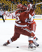 Colin Moore (Harvard - 12), Justin Courtnall (BU - 19) - The Boston University Terriers defeated the Harvard University Crimson 3-1 in the opening round of the 2012 Beanpot on Monday, February 6, 2012, at TD Garden in Boston, Massachusetts.