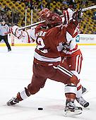 Colin Moore (Harvard - 12), Justin Courtnall (BU - 19) - The Boston University Terriers defeated the Harvard University Crimson 3-1 in the opening round of the 2012 Beanpot on Monday, February 6, 2012, at TD Garden in Boston, Massachusetts.