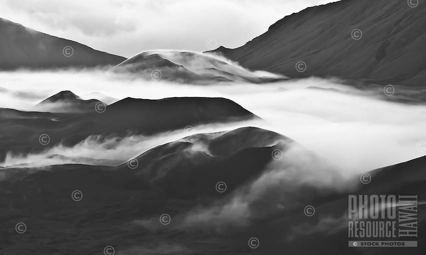 "Clouds settle around cinder cones in Haleakala ""Crater"" in Haleakala National Park, Maui."