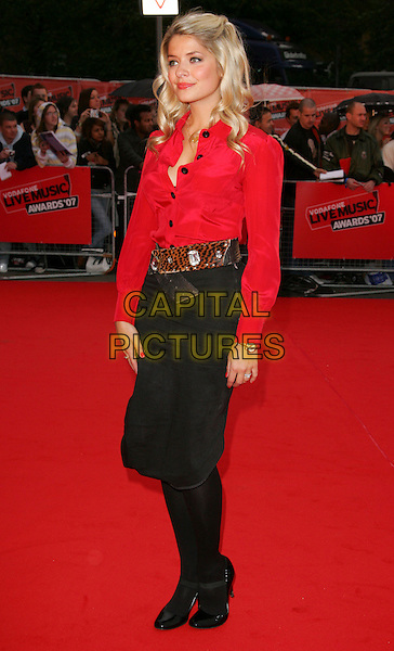 HOLLY WILLOUGHBY.Red carpet arrivals at the Vodafone Live Music Awards at Earls Court, London, England. .September 19th, 2007.full length red shirt blouse leopard print belt black buttons skirt tights shoes .CAP/ROS.©Steve Ross/Capital Pictures