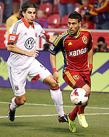 Javier Morales #11 of Real Salt Lake moves past Dejan Jakovic #5 of D.C. United during the first half of the U.S. Open Cup Final on October  1, 2013 at Rio Tinto Stadium in Sandy, Utah.