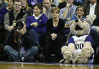 04 February 2010:  Washington Huskies mascot Harry sits on the floor next to the fans and photographers covering the game against Arizona. Washington won 81-75 over Arizona at the Bank of America Arena in Seattle, WA.