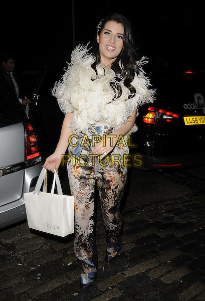 Grace Woodward.The InStyle Best Of British Talent party, Shoreditch House, Ebor St., London, England..January 26th, 2012.full length black white beige floral print trousers fur wrap goody bag.CAP/CAN.©Can Nguyen/Capital Pictures.