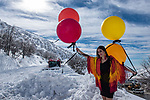 A fashion model poses in the snow for a balloon advertisement in the Mount Hermon ski resort, in the Israeli-occupied Golan Heights, on January 10, 2019. Photo by: Ayal Margolin-JINIPIX