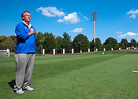 Duke head coach Robbie Church faces the flag as the national anthem plays before the game at Klockner Stadium in Charlottesville, VA.  Virginia defeated Duke, 1-0.