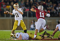 Tommy Rees (11) throws as Stanford Cardinal linebacker Shayne Skov (11) pressures in the second quarter.