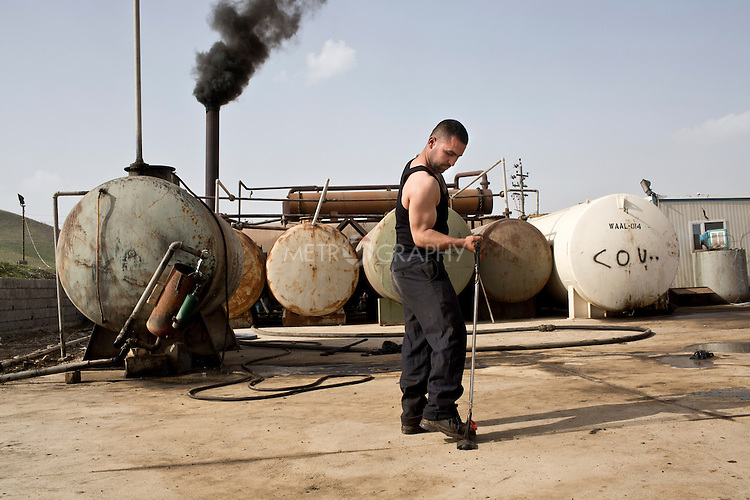 15/02/15 --TANJERO, IRAQ: Zaidoon (20), poses in front of an oil refinery with a piece of tension workout equipment.<br /> <br /> Zaidoon is an amateur bodybuilder who was displaced from Sinjar by ISIS. He now lives with his displaced family next to an oil refinery in the Kurdish Region of Iraq. He runs the refinery 24 hours a day with little to no safety equipment along with his brothers and a cousin. Reporting for this article was supported by a grant from the Pulitzer Center on Crisis Reporting