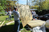 Group Activity with fencing including l to r: Ben Reale, Jeff O'Connor and  Roy Reale  - Wellpoint Community Service Day | New Haven CT