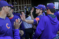 Starting pitcher Clate Schmidt (32) of the Clemson Tigers is congratulated after coming out of the game in the sixth inning of the Reedy River Rivalry against the South Carolina Gamecocks on Saturday, March 5, 2016, at Fluor Field at the West End in Greenville, South Carolina. Clemson won, 5-0. (Tom Priddy/Four Seam Images)