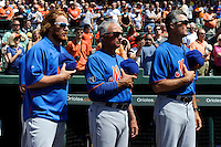 New York Mets infielder Justin Turner, manager Terry Collins #10 and coach Bob Geren before a Spring Training game against the Baltimore Orioles at Ed Smith Stadium on March 30, 2013 in Sarasota, Florida.  (Mike Janes/Four Seam Images)
