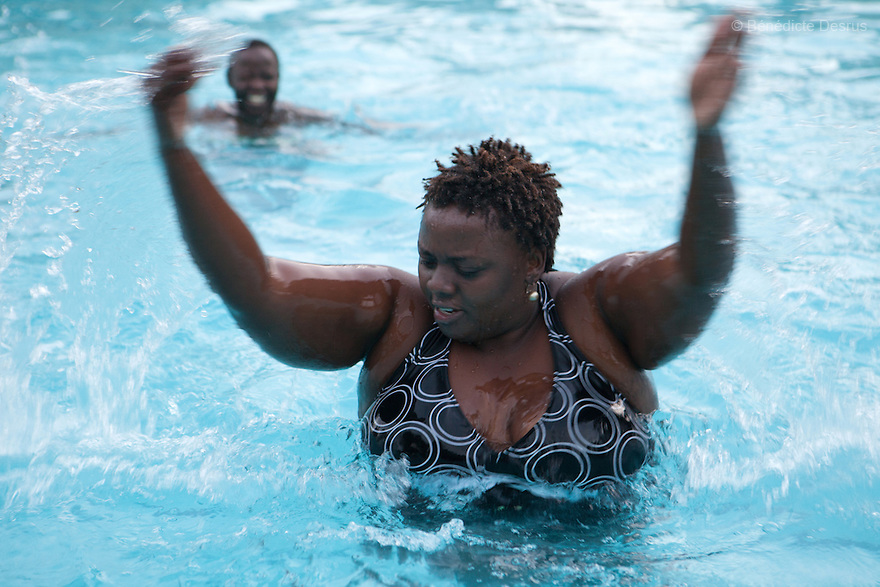 "Ruth does swimming workouts with Alice Ojwang-Ndong, her nutritionist and dietetic consultant in Nairobi, Kenya on December 11, 2012. Ruth Gathu is a 35 year-old Kenyan woman who works as an office administrator. She weighs 299 pounds and weighs 175 centimeters, with a BMI of 44.3. She says: ""In Kenya, people don't spend money on nutrition programs""…""Obesity is in all the social class in Kenya, the rich, the middle class and the poor."" Nairobi has a high prevalence of overweight and obesity among women, especially those in the middle and upper class. Like elsewhere in the world, the main drivers of obesity in Kenya are rapid urbanization and westernization, that have resulted in changing lifestyles such as increased consumption of ""unhealthy diets"" and adoption of sedentary lifestyles. Photo by Bénédicte Desrus"