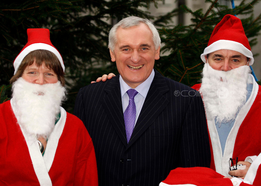 06/12/'07 Taoiseach Bertie Ahern pictured at Government Buildings with three of the Santas who are part of an attempt  to set a new World Record. The Santas are part of a World record attempt to have 10,000 Santas man the city of Derry's Walls on the 9th of December 2007, no later than 11.15am. The aim will be to raise money for local charities - and to get the Maiden City into the Guinness Book of Records. There will also be attempst in Liverpool, Las Vegas and Glasgow over the coming weeks....Picture Collins, Dublin, Colin Keegan.