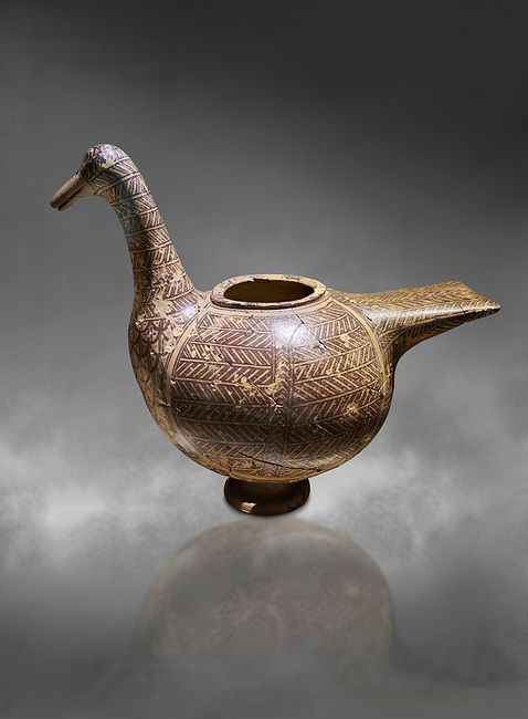 Phrygian pottery vessel in the shape of a goose decorated with geometric deigns from Gordion. Phrygian Collection, 8th century BC - Ancora Archaeological MuseumMuseum of Anatolian Civilisations Ankara. Turkey. Against a grey background