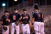 San Jose Giants relief pitcher JJ Santa Cruz (50) is welcomed to the mound by Ryan Kirby (10), Kyle McPherson (2), and Joey Bart (9) during a California League game against the Visalia Rawhide on April 12, 2019 at San Jose Municipal Stadium in San Jose, California. Visalia defeated San Jose 6-2. (Zachary Lucy/Four Seam Images)