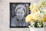 """The House of Sharing for Comfort Women, June 7, 2016 : A portrait of the late comfort woman, Kang Deok-gyeong is seen on a monument to her at the House of Sharing in Gwangju, Gyeonggi province, about 30 km (18 miles) southeast of Seoul, June 7, 2016. The House of Sharing is a shelter for living South Korean """"comfort women"""", who said they were forced to become sexual slavery by Japanese military during the Second World War. It was founded in 1992 with funds organized by Buddhists and other civic groups. The Museum of Sexual Slavery by Japanese Military locates in the shelter. (Photo by Lee Jae-Won/AFLO) (SOUTH KOREA)"""