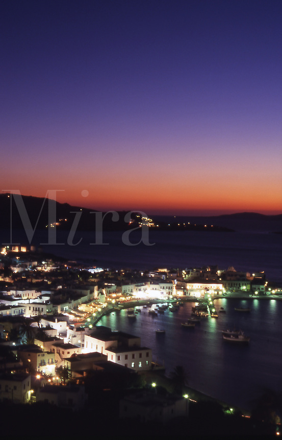 Greece. Mykonos Town Harbor at dusk..