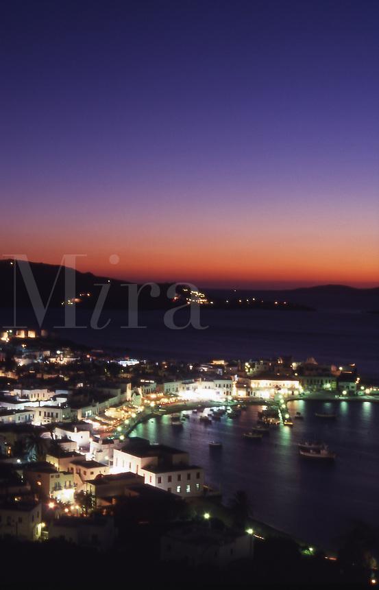Greece. Mykonos Town Harbor at dusk..