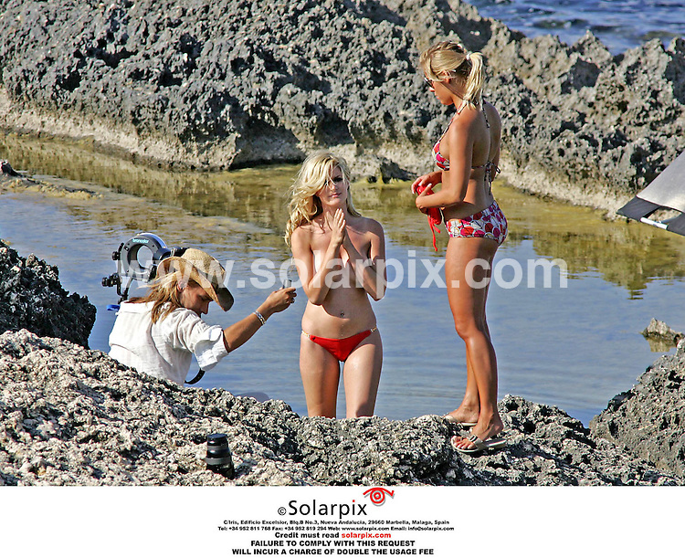 ALL-ROUND EXCLUSIVE PICTURES BY SOLARPIX.COM.MUST CREDIT SOLARPIX.COM OR DOUBLE USAGE FEE CHARGED*.Hollyoaks favourites, Sarah Dunn and Gemma Bissix - Mandy Hutchinson and Clare Devine in the show, were in Spain this week, on a Hollyoaks calendar shoot. Sarah Dunn looked amazing as she posed on rocks overlooking the sea. She even gave the photographer a flash as she changed her bikini between shots. The two girls took time out between sets to sunbathe and relax on the beach..REF: 2483 MSR