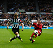 1st October 2017, St James Park, Newcastle upon Tyne, England; EPL Premier League football, Newcastle United versus Liverpool; Matt Ritchie of Newcastle United crosses despite Alberto Moreno of Liverpool best efforts