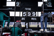 Ground staff manage the score-board at the Firozshah Kotla Cricket grounds in Delhi, India