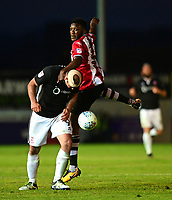 Lincoln City's Matt Rhead vies for possession with Exeter City's Troy Archibald-Henville<br /> <br /> Photographer Chris Vaughan/CameraSport<br /> <br /> The EFL Sky Bet League Two Play Off Second Leg - Exeter City v Lincoln City - Thursday 17th May 2018 - St James Park - Exeter<br /> <br /> World Copyright &copy; 2018 CameraSport. All rights reserved. 43 Linden Ave. Countesthorpe. Leicester. England. LE8 5PG - Tel: +44 (0) 116 277 4147 - admin@camerasport.com - www.camerasport.com