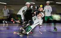 15 MAR 2014 - BIRMINGHAM, GBR - Baltic Basterd of Team Germany (centre in black) knocks over Mick Dastardly of Ireland during the bout between the two countries at the inaugural Men's Roller Derby World Cup in the Futsal Arena in Birmingham, West Midlands, Great Britain (PHOTO COPYRIGHT © 2014 NIGEL FARROW, ALL RIGHTS RESERVED)