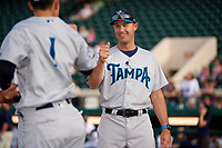 Tampa Tarpons manager Pat Osborn (13) fist bumps players during introductions before a game against the Lakeland Flying Tigers on April 5, 2018 at Publix Field at Joker Marchant Stadium in Lakeland, Florida.  Tampa defeated Lakeland 4-2.  (Mike Janes/Four Seam Images)