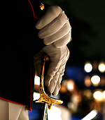 A United States Marine sergeant rests his hands on his sword during a parade attended by U.S. President George W. Bush May 5, 2006, at the Marine Barracks on Capitol Hill in Washington, DC. A House panel this week approved a measure that would increase funding to add 5,000 more Marines, bringing the overall troop size for the Corps to 180,000. <br /> Credit: Joshua Roberts / Pool via CNP