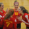 Paige Zimmerly #13 of Sacred Heart Academy, second from right, celebrates with teammates, from left, Riley Leimbach #18, Carlea Mirante #7 and Helena Gunther #10 after taking a point in the third set of a CHSAA varsity girls volleyball match against host St. John the Baptist High School in West Islip on Thursday, Oct. 12, 2017.