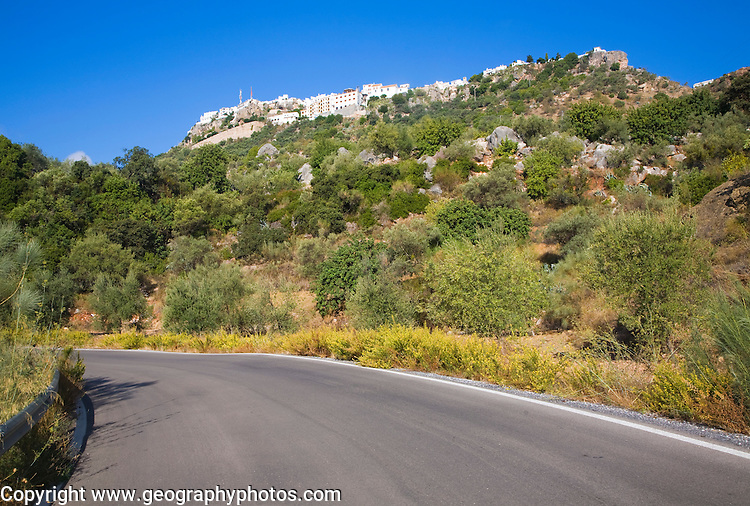 Road leading to the the hilltop Andalusian village of Comares, Malaga province, Spain