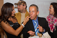 "Norbert ""Norbi"" Schobert (2nd R) tastes some sugar on the finger of his wife Reka Rubint (L) during a press conference on her husband's franchise called Update in Budapest, Hungary. Tuesday, 18. May 2010. ATTILA VOLGYI"
