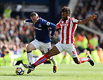 Everton's Wayne Rooney tussles with Stoke's Eric Maxim Choupo-Moting during the premier league match at Goodison Park, Liverpool. Picture date 12th August 2017. Picture credit should read: David Klein/Sportimage