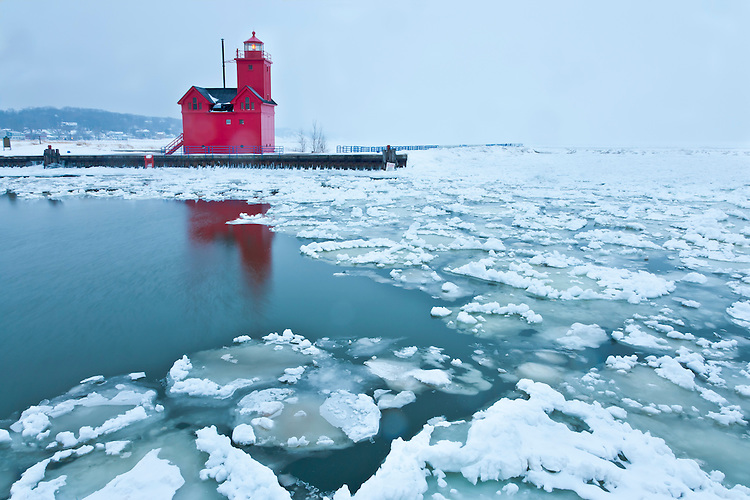 Snow storm and ice formations at the Holland Harbor Lighthouse on the shore of Lake Michigan; Holland Harbor, MI