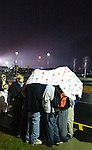 NEWTOWN, CT - 16 December 2012-121612EC06--    Students huddle together underneath a Red Cross blanket Sunday night outside Newtown High School.  Hundreds showed up and waited hours to be a part of the interfaith vigil Sunday night where President Obama made remarks.  The line twisted around the side of the high school and around the parking lot.  Erin Covey Republican-American.