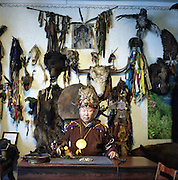 "The chairman of ""Bear Spirit"" Dopchun-ool Kara-ool Tyulyushevich. Famous for his predictions on the rocks, cards and ram's shoulder-blade. He is also a healer shecialized in neurological disorders and kidney diseases. Uses energetic masage and hipnosis. Rituals are combined with singing - connection with  spirits-helpers (eerens). Kyzyl. Tuva. Russia. 2009"
