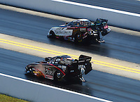 Apr. 14, 2012; Concord, NC, USA: NHRA funny car drivers Tim Wilkerson (top) and Blake Alexander race during qualifying for the Four Wide Nationals at zMax Dragway. Mandatory Credit: Mark J. Rebilas-