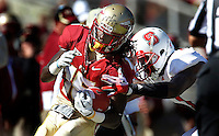 TALLAHASSEE, FL 10/29/11-FSU-NCST102911 CH-Florida State's Greg Dent completes a 26-yard pass and run as N.C. State's David Amerson pushes him out of bounds during second half action Saturday at Doak Campbell Stadium in Tallahassee. The Seminoles shut out the Wolfpack 34-0..COLIN HACKLEY PHOTO