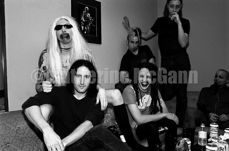 "NEW YORK - JUNE 1995:  American rock band Marilyn Manson and American musician Trent Reznor of Nine Inch Nails backstage at the taping of the last episode of the ""Jon Stewart Show"" (L-R: Marilyn Manson (in blonde wig), Trent Reznor, Twiggy Ramirez, Ginger Fish, Daisy Berkowitz (standing), and Madonna Wayne Gacy) in June 1995 in New York City, New York.  Reznor paid a visit to the band, who were the musical guests on the show. (Photo by Catherine McGann).Copyright 2010 Catherine McGann"