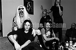 """NEW YORK - JUNE 1995:  American rock band Marilyn Manson and American musician Trent Reznor of Nine Inch Nails backstage at the taping of the last episode of the """"Jon Stewart Show"""" (L-R: Marilyn Manson (in blonde wig), Trent Reznor, Twiggy Ramirez, Ginger Fish, Daisy Berkowitz (standing), and Madonna Wayne Gacy) in June 1995 in New York City, New York.  Reznor paid a visit to the band, who were the musical guests on the show. (Photo by Catherine McGann).Copyright 2010 Catherine McGann"""