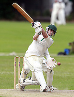 Tom Wakeford hits out for North London during the Middlesex County Cricket League Division Three game between Highgate and North London at Park Road, Crouch End on Sat July 12, 2014