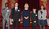 London, Uk. 15/10/2015. L-R: Tawanda Mulalu, 18, Senior Runner-up from Botswana, Paraschos Cant, 16, Senior Winner from Cyprus, HRH The Duchess of Cornwall, Nathan Swain, 11, Junior Winner, from Tristan da Cunha and Martina Watler, 13, Junior Runner-up, from the Cayman Islands. The Duchess of Cornwall on behalf of Her Majesty The Queen, Patron of The Royal Commonwealth Society, holds a reception for winners of The Queen's Commonwealth Essay Competition at Buckingham Palace. The Queen's Commonwealth Essay Competition was founded in 1883 and is the world's oldest international schools' writing contest. This year's competition, sponsored by Cambridge University Press, received more than 13,000 entries from over 600 schools in 49 Commonwealth countries and territories. The Duchess of Cornwall hands out awards to young writers who have travelled from across the Commonwealth to attend the reception. This year's winners have come from Cyprus, Botswana, The Cayman Islands and as far away as Tristan da Cunha - over 9000km away.