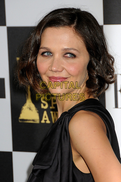 MAGGIE GYLLENHAAL.25th Annual Film Independent Spirit Awards - Arrivals held at the Nokia Event Deck at L.A. Live, Los Angeles, California, USA..March 5th, 2010.headshot portrait black one shoulder strap side .CAP/ADM/BP.©Byron Purvis/AdMedia/Capital Pictures.