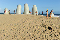 "URUGUAY Punta del Este, sculpture La mano ( The hand ) by Chilean artist Mario Irarrázabal. It depicts five human fingers partially emerging from sand, and is located on Parada 1 at Brava Beach. It is also known as either Hombre emergiendo a la vida (Man Emerging into Life), Monumento los Dedos (Monument of the Fingers) or Monumento al Ahogado (Monument to the Drowned) / URUGUAY Badeort und Seebad Punta del Este  ""Los Dedos"" (die Finger), eine circa fünf Meter breite und drei Meter hohe Steinskulptur in Form einer Hand im Strandsand"