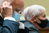 Dr. Robert Redfield, Director of the Centers for Disease Control and Prevention; adjusts his mask alongside Dr. Anthony†Fauci (2nd-L), Director, National Institute for Allergy and Infectious Diseases, National Institutes of Health, during a House Energy and Commerce Committee hearing on the Trump Administration's Response to the COVID-19 Pandemic, on Capitol Hill in Washington, DC on Tuesday, June 23, 2020. <br /> Credit: Kevin Dietsch / Pool via CNP