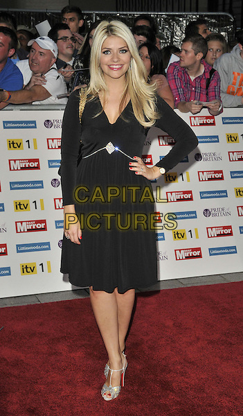 Holly Willoughby.'The Daily Mirror's Pride Of Britain Awards 2011' at Grosvenor House Hotel, London, England..3rd October 2011.full length black dress hand on hip silver shoes  .CAP/CAN.©Can Nguyen/Capital Pictures.