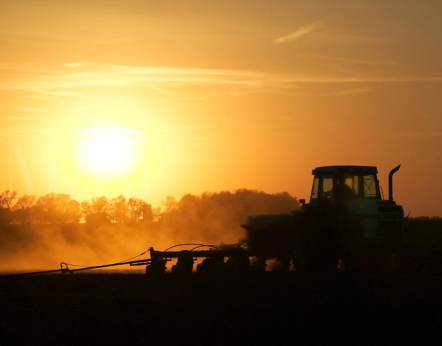 Planting corn at sunset, Iow