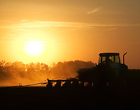 Planting corn at sunset, Iow
