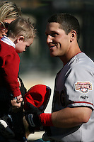 April 10, 2010:  Adam Fox of the Harrisburg Senators with his nephew before a game at Blair County Ballpark in Altoona, PA.  Harrisburg is the Double-A Eastern League affiliate of the Washington Nationals.  Photo By Mike Janes/Four Seam Images