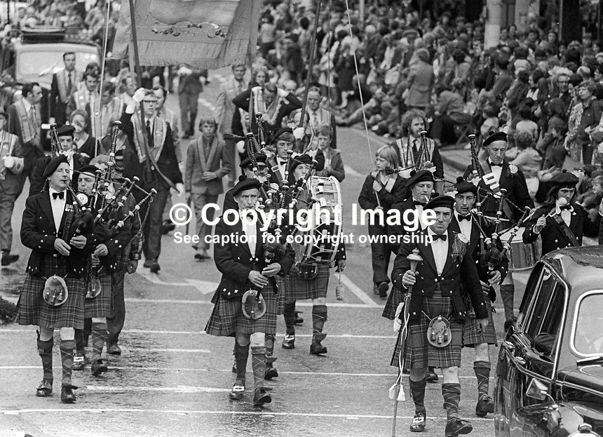 Twelfth, 12th of July, Orangemen's parade, Belfast, N Ireland, UK, 1973 - A pipe band taking part in the parade. 197307120503d<br /> <br /> Copyright Image from Victor Patterson, 54 Dorchester Park, Belfast, UK, BT9 6RJ<br /> <br /> t: +44 28 9066 1296<br /> m: +44 7802 353836<br /> <br /> e1: victorpatterson@me.com<br /> e2: victorpatterson@gmail.com<br /> <br /> IMPORTANT: My Terms and Conditions of Business are at www.victorpatterson.com